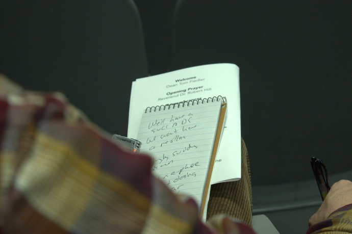 The seasoned reporter takes notes, just as Carr did himself.