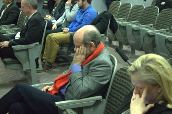 Professor Chris Daly wears the red scarf in honor of David Carr, with whom he had a short-lived, yet close relationship.