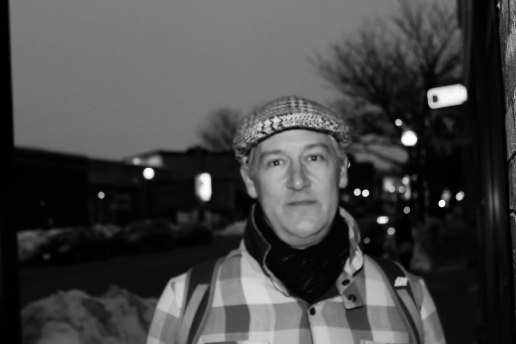 Bryan McMurray, Inman Square resident, heads to the market, fighting the white, frozen sidewalks on a cold Tuesday night, the day before the 40 degree Wednesday respite from the cold.