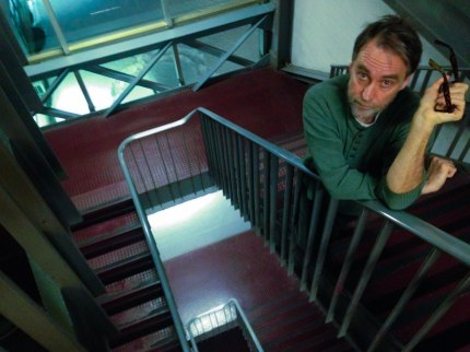 Professor of journalism Peter Smith shows the class how to take (and model for) a good picture in the North Stairwell of Boston University's COM building.