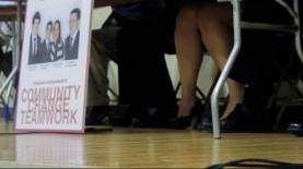 Members of Team BU sit nervously during a debate between the three competing slates.