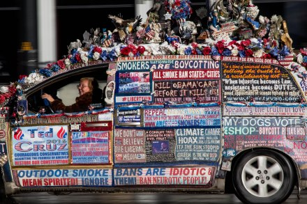 MANCHESTER, New Hampshire, 8 February 2016: A Cruz supporter drives her politically colorful van down Elm Street in Manchester, New Hampshire on Tuesday. (Photo by: Jacob G. Dmochowski/BUNS)