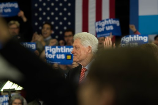 MANCHESTER, New Hampshire, 8 February 2016: Former President Bill Clinton looks on as his wife Hillary Clinton makes her concession speech at Southern New Hampshire University after losing to Bernie Sanders in the primary on Tuesday. (Photo by: Jacob G. Dmochowski/BUNS)