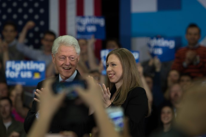 MANCHESTER, New Hampshire, 8 February 2016: Hillary Clinton's wife Bill and daughter Chelsea look on as she delivers a speech on Tuesday to the crowd at Southern New Hampshire University. (Photo by: Jacob G. Dmochowski/BUNS)