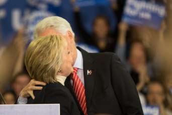 MANCHESTER, New Hampshire, 8 February 2016: Hillary Clinton celebrates the event at Southern New Hampshire University with her husband Bill on stage on Tuesday. (Photo by: Jacob G. Dmochowski/BUNS)