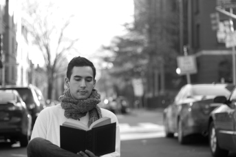 """Felix Teich reads Joyce's """"A Portrait of the Artist as a Young Man"""" on Second Street in Cambridge on 28 February 2016."""