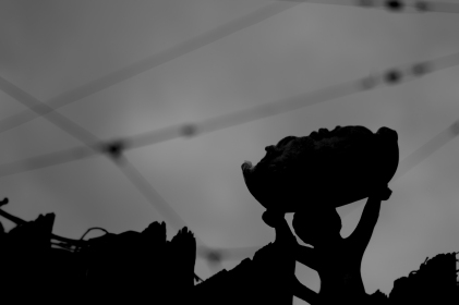 A statue of a cherub sits among the wires of the trains at Lechmere station on 3 April 2016.
