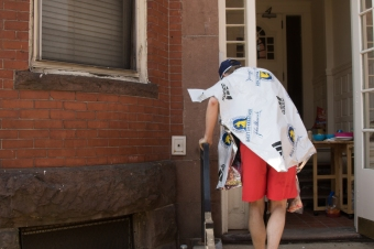 A tired marathoner retires to his home Monday on Newbury street after completing the 2016 Boston Marathon.