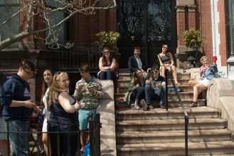 Colleg-aged spectators enjoy the sixty-degree day on Newbury Street on Patriots' Day, 18 April 2016.