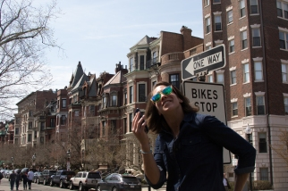 A happy marathon spectator takes a quick phone call on Newbury Street on 18 April 2016.