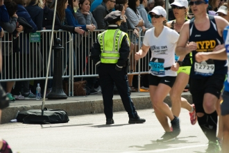 Police prescence was heavy but the scene was calm during the Boston Marathon on Boylston Street on 18 April 2016.