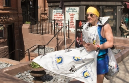 A marathoner walks down Newbury Street after the race on 18 April 2016.